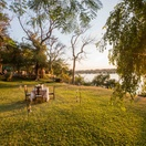 Dine on the banks of the Zambezi near Victoria Falls